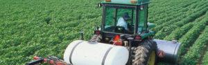 Tractpr spraying agronomic crop