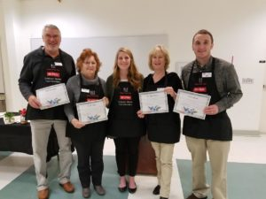 Four Extension Master Food volunteers holding their certificates. Agent Morgan McNight, center.