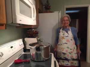 Woman in front of stove