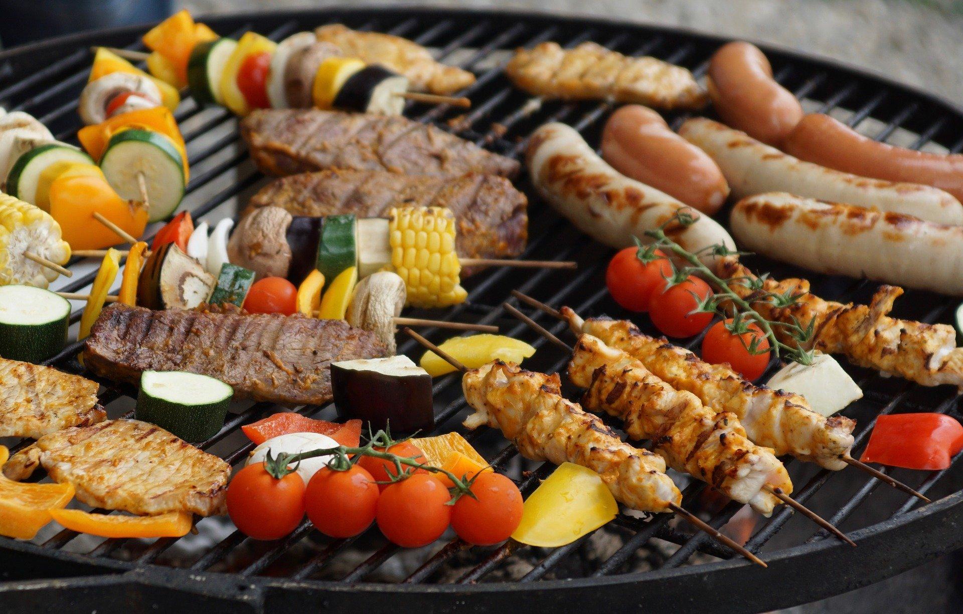 kebabs and vegetables on skewers on grill