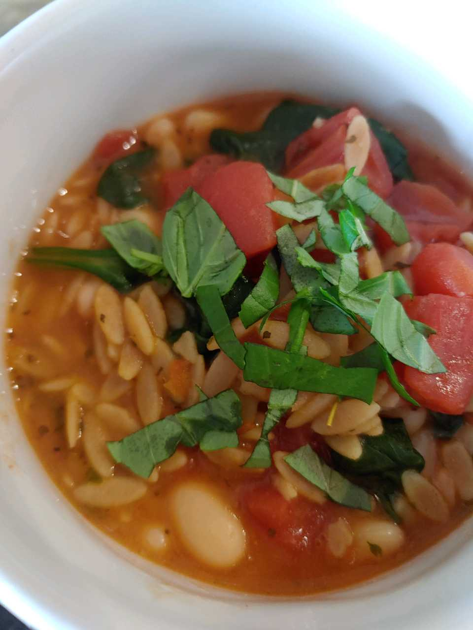 Close up of quick bean and spinach soup