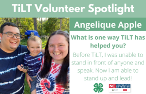 Angelique featuring her partner and son with the following text to the right of the image. TiLT Volunteer Spotlight. Angelique Apple. What is one way TiLT has helped you? Before TiLT I was unable to stand in front of anyone and speak. Now I am able to stand up and lead!